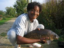 Jenny with a double figure mirror carp