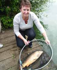 Julie with her first ever fish, a cracking 10lb common